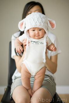 """As you all know, I crocheted Myla many different items when I was pregnant with her, and I wanted to make sure that Brielle similarly had special items made just for her! I had seen the free lamb hat pattern that Sarah of""""Repeat Crafter Me"""" had posted two years ago, but I was reminded of it when a reader was showing me pictures of what she herself had crocheted in advance for her baby (Hi Michelle and baby Milana)! Sarah designs the cutest baby hats, and I thought it was only fitting…"""