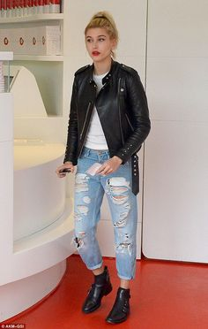 Casual style: Hailey, 18, was dressed down in ripped boyfriend jeans and a white T-shirt
