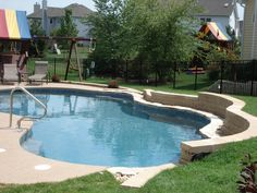 Children's swing set and Free Form Pool design #freeform #swimmingpool #pools #BarringtonPools