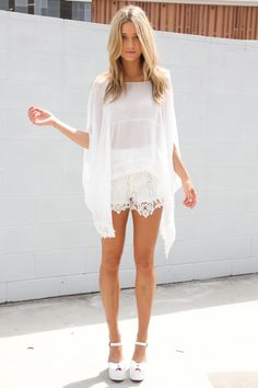 love white on white on white and flowy sleeves and lace shorts