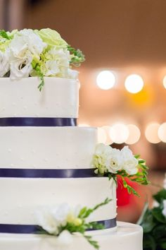 Navy and white wedding cake with flowers