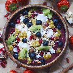 """Secretly"" green smoothie bowl topped with coconut granola, kiwi, passionfruit, blueberries and pomegranate"
