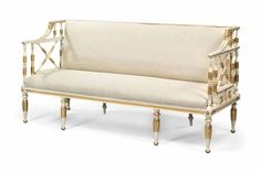 A swedish parcel-gilt white-painted sofa