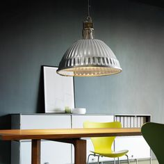 Suspension lamp with faceted anodized aluminum reflector that looks like a pudding mold. Also available with clear tempered glass disc and edge ring.