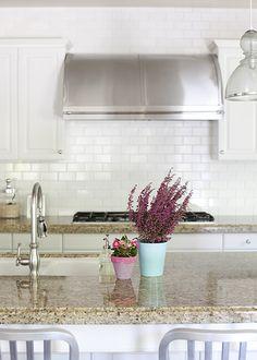 New back splash for kitchen white shiny subway tile with white grout.