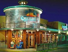 Jimmy Buffett Owns A Large Chain Of Cheeseburger In Paradise Restaurants Creating Tropical Atmosphere For Its Guests And His Music Playing While