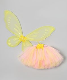 The biggest tea party in the history of Fairy City is only days away, and a girl has got to look her most fabulous to attend. This pixie pairing comes with a colorful tutu touting a crochet waistband and removable flower clip plus soft, stretchy wings that slip on comfortably over the shoulders. Fits ages 1 to 5 yearsIncludes tutu, wings and clip