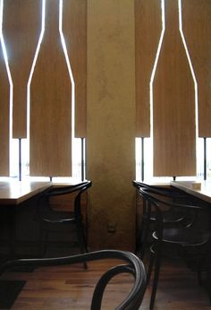RED PIF RESTAURANT AND WINE SHOP,   Great idea for windo covers instead of window treatments. Put on a swivel.