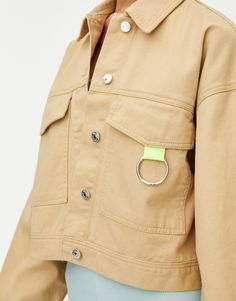 Rosalía long sleeve sand-coloured denim jacket with a cropped silhouette, a ring detail, large front pockets and front button fastening. Coloured Denim Jacket, Pull N Bear, Color Trends, Raincoat, Silhouette, Long Sleeve, Clothes, Women, Spring