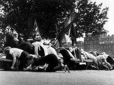 Robert Capa. Paris. Place de l'Hôtel de Ville. August 26th, 1944. German troops started shooting against the parade celebrating the liberation of the cit...