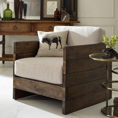 Weathered planked sides and a boxy shape offer statement-making style and casual comfort for your living or family room. The Franklin Chair has a neutral linen seat, reclaimed oak and acid-washed iron