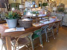 FRENCH COUNTRY COTTAGE: Old folding chairs, mis-matched, with farm table