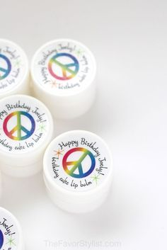 She may be small, but she's sassy. She speaks her mind and stands up for others. And don't ever ask her to choose just one favorite color. If this sounds like your birthday girl, maybe she needs peace, love, and rainbows for her party favors? These lip balms are just the thing. Click to see how we can personalize for your one-of-a-kind girl. #rainbowparty, #kidsbirthday, #birthdayparty, #partyfavors