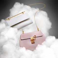 Handbags in clouds of smoke. Creative still life photography of fashion…