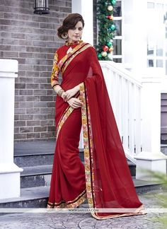 Make the heads flip whenever you dress up in this lovely red georgette designer saree. The ethnic embroidered and patch border work in the dress adds a sign of magnificence statement with your look. C...