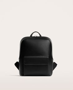 Image 1 of BLACK BACKPACK WITH FLAP AND SLOGAN from Zara