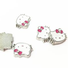 Hello Kitty Floating Charms, Kitty Floating Charms, Memory Locket by AlnSupplies on Etsy https://www.etsy.com/listing/228128624/hello-kitty-floating-charms-kitty