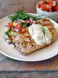 Greek Style Pork Chops -- Greek Style Pork Chops with a Cucumber and Tomato Salad is a low carb, healthy meal full of flavor!