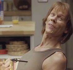 "Kevin Bacon good-heartedly slips back into the skin of previous films roles, including his turn in Friday the 13th. See him - with his green tank top, arrow sticking out of his chest – interact with other ""Bacons"" from A Few Good Men, Apollo 13 and Footloose."