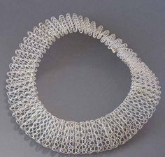 Necklace | Hanne Behrens. Woven lace from fine silver and 585 gold