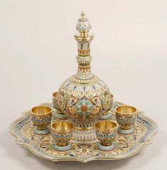 A Russian silver gilt and cloisonne enamel vodka set with tray, Pavel Ovchinnikov, Moscow, late 19th century.