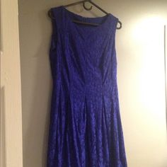 Royal blue sleeveless lace dress Knee length, royal blue lace over satin worn only once. Flattering shape with darts at waist. Purchased at Carsons. Dresses Midi
