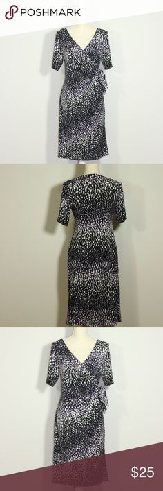 """Motherhood Faux Wrap Side Tie Dress Size M Pre-Loved but in excellent used condition, Motherhood faux wrap side tie dress size M. Features print in purple, black and white and v neck.  Approximately 19"""" from armpit to armpit Approximately 40"""" from shoulder to hem Motherhood Maternity Dresses Midi"""