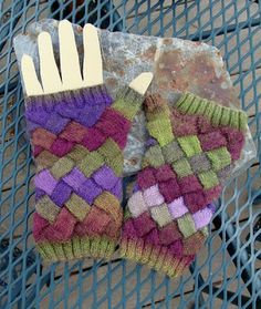 Try these entrelac fingerless gloves in a variegated Sock-Ease yarn for a cool color gradient.  Pattern by Bead Knitter Patterns