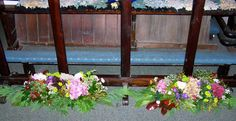St Giles, Ludford, Harvest Festival 2012 - arrangements on the floor in front of the front pew.  Might do something similar on the altar step for a wedding.