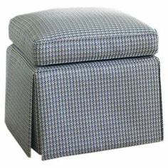 """Bring country-chic style to your living room or master suite with this charming ottoman, featuring a hounds tooth design in blue and white.   Product: OttomanConstruction Material: Wood, fabric and foamColor: Blue and whiteDimensions: 22"""" H x 21"""" W x 21"""" D"""