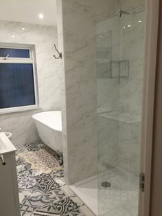 Gemma from Potters Bar uses funky floor tiles and an exquisite marble walk in shower. We especially think the roll top bath completes the style. #VPShareYourStyle