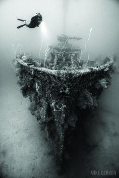 Scuba diver underwater diving in Truk Lagoon Shipwreck.