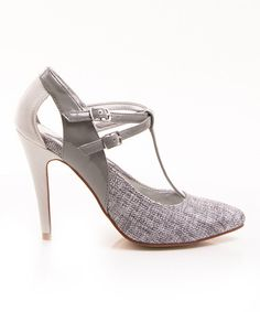 Elevated to posh perfection, the leather and linen upper of this pump is pure luxe, while the T-strap silhouette and contrasting textures promise sleek style.3.75'' heelBuckle closureLinen / leather upperMan-made sole