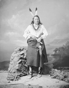 Portrait (Front) of On-Pon-Ton-Ga or Ump-Pa-Tonga (Big Elk) - Ponca, Called Robert Primeau, Son of Lone Chief, in Partial Native Dress with Bear Claw Necklace and Holding Pipe-tomahawk 14 NOV 1877 by William Henry Jackson (1843-1942)