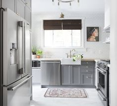 This kitchen from Chris Loves Julia makes use of IKEA cabinet bases and Semihandmade Shaker-style cabinet fronts, for a custom look at a fraction of the price.