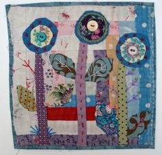 Three Flowers Hand Appliqued and Embroidered Textile Collage
