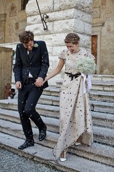 A polka dot dress for the bride gives a black and white affair extra pizzaz! Not usually into non white wedding gowns but this is lovely.