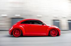VW Red New Beetle with red wheels