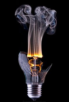 I really like this shot of a light bulb caught alit with a flame because it captures the smoke really well and it is a very creative shot.