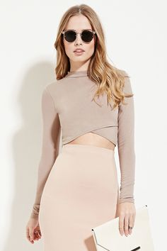 Forever21-The khaki long-sleeve crop top with an asymmetrically layered front hem and the light pink midi skirt. In the earth tone, it makes people feel comfortable. Also, crop top and hight waist skirt always stand slim waist line out.