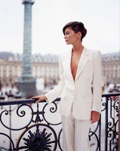 Audrey Tautou in crisp white suit (Place Vendôme as a background is not too shabby either :)