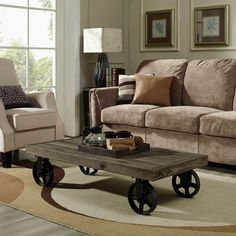 - Info - Colors - Dimensions Shield your gatherings with a stalwart coffee table positioned on four immobile metal wheel casters. Made from a solid pine wood top, Fortress defends industrial modern de