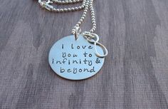 I love you to infinity and beyond necklace created in sterling silver by Kristen's Custom Creations