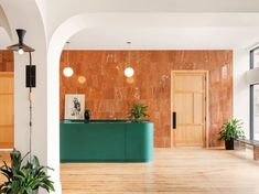 The hotel's dark green reception desk is set against a wall of orange Breccia Pernice marble. These elements and the lobby's contemporary furniture selections contrast and complement the building's original features, such as wood floors that were preserved throughout. Portland Hotels, Public Hotel, Century Hotel, Private Dining Room, Unique Hotels, Guest Bedrooms, Contemporary Furniture, The Originals, Home
