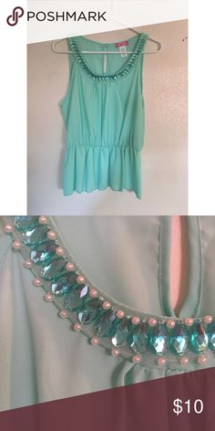 Peplum Top Minty peplum top with beautiful embellishment along the neckline. Rarely worn. Great condition. Body Central Tops Tank Tops