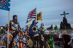 Men wearing medieval knight's costumes ride horses during a two-day re-enactment of crowning celebrations from September 2, 1347 when Charles IV was crowned the King of Bohemia, at Charles Bridge on September 3, 2016 in Prague, Czech Republic. 2016 is the 700th anniversary of Charles IV's birth and is marked with commemorative events in Prague and around the Czech Republic. Charles IV, of the Luxembourg dynasty, was the German King, King of Bohemia and Holy Roman Emperor from 1335 until his…