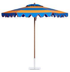 Cirque teak umbrella in Tango Orange and Indigo, with scalloped style valance and Orange edge binding.