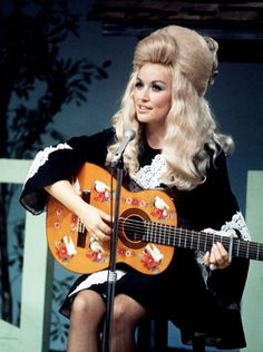 """Dolly Parton performs during a taping of the half-hour syndicated """"The Porter Wagoner Show"""" at WSM-TV studios."""