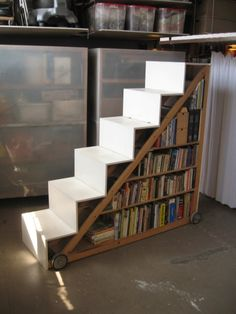 Bookstairs on Wheels by superorganismsubmitted via Bookshelf Porn's Facebook page. Great bookshelves for basement or garage workshop how-to books.