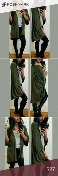 《••NEW••》 OLIVE GREEN RIBBED CARDIGAN Love this cardigan.  It's flowy lightweight style is perfect for lounging around or for those casual lazy days. Ribbed knit. Flowy sleeves. Totally chic. Fits TTS.  Fabric Content:   Sizes available:  S M l Modeling size Medium •  ●•••》PRICE FIRM UNLESS BUNDLED《•••● JMAY4354 Sweaters Cardigans